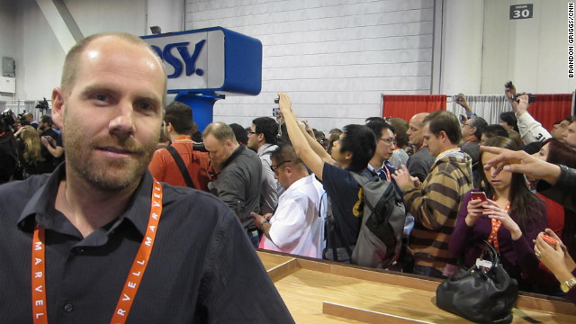 Xybotyx co-founder David Shafter in his CES booth, with Justin Bieber fans crowding in the background.