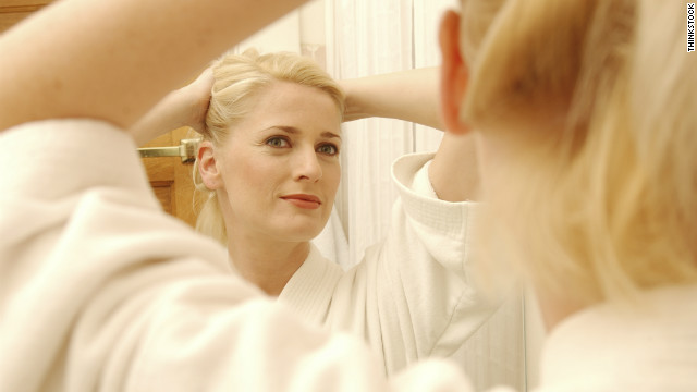 Instead of going to a salon, save money by putting your hair in an elegant updo on your own.