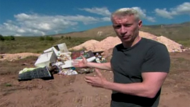 2010: CNN's Anderson Cooper finds a mass grave on the outskirts of Haiti's earthquake-shattered capital Port-au-Prince.