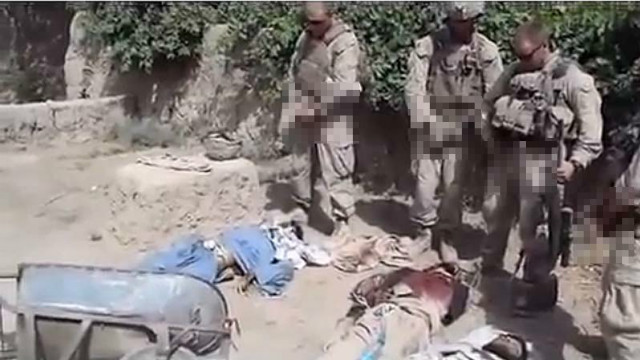 A pixilated still from a video purporting to show U.S. Marines urinating on dead Taliban fighters