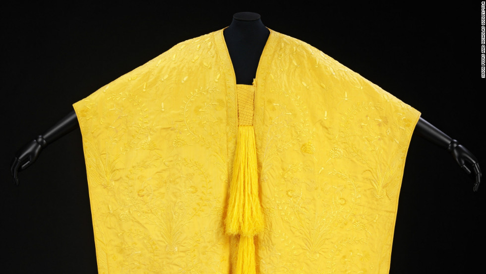 A cape and a scarf made from the silk of Madagascan golden orb spiders have gone on display at the Victoria and Albert Museum in London.