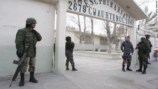 Security forces in Ciudad Juarez, Mexico, respond to a shooting at an elementary school that left one man dead.