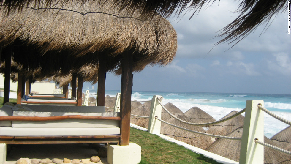 "Donna Panabaker captured this view from a palapa in Cancun. ""If there's something more relaxing than lounging in a shaded, comfy bed while overlooking a beautiful beach like this one, I don't know what it is!"""