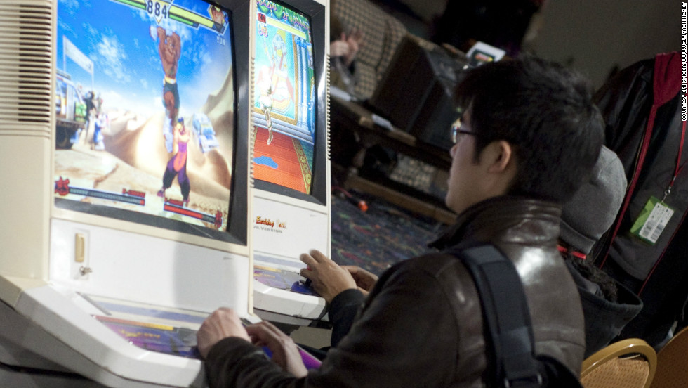 A gamer enjoys the pleasures of one of MAG's many arcade cabinet video games.