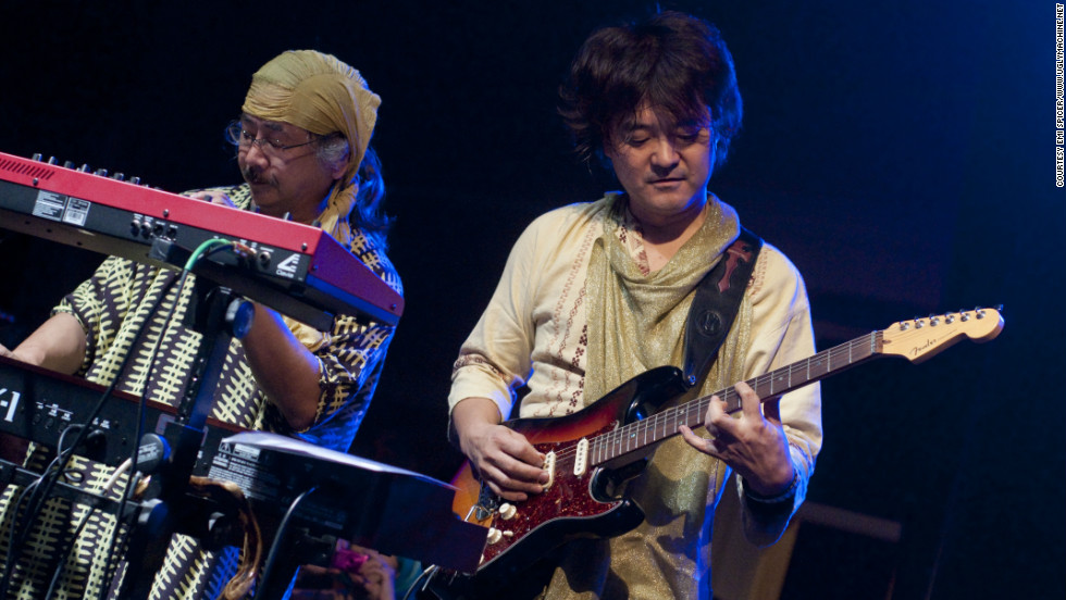 """Final Fantasy"" composer Nobuo Uematsu and his guitarist live on stage during the Earthbound Papas performance."