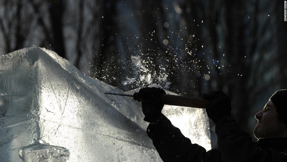 A sculptor works on a block of ice during the London Ice Sculpting Festival in Canary Wharf, east London, on January 13.