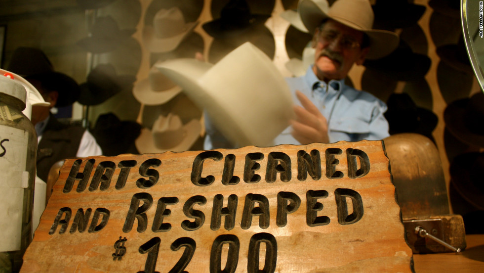 """Ranchers can also take care of their own personal beauty needs.  Miles Flatley, pictured here, uses a steam table to soften the felt and re-shape hats that have gotten dirty or stretched out.  """"A lot of cattlemen come to the stock show once a year and this is the only time they get their hats reshaped,"""" he said.  """"Some are more vain and come see me every few weeks."""""""