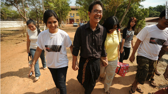 Myanmar blogger and prominent political activist Nay Phone Latt leaves with relatives following his release from detention on January 13, 2012.