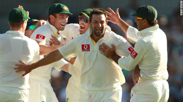 Australia's Ben Hilfenhaus is congratulated by his teammates after dimissing India's VVS Laxman for a duck in Perth