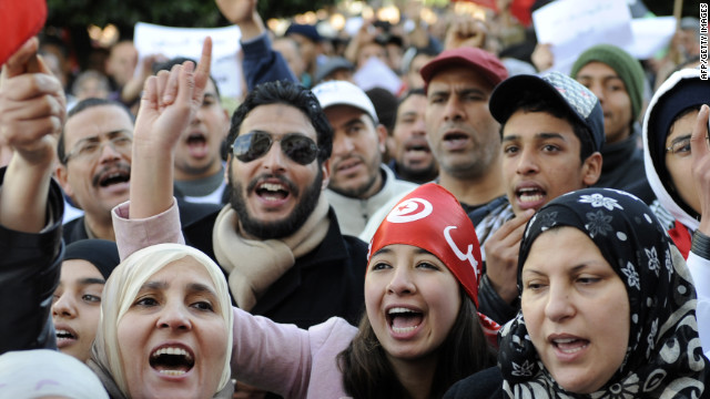People in Tunis shout slogans to commemorate the first anniversary of a demonstration that led to the fall of their president.