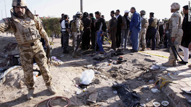 Iraqi security forces inpsect the scene of a suicide bombing that killed more than 50 people Saturday near Basra.