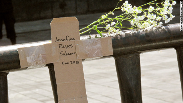 Activists in Mexico City created a cardboard cross marking a victim's death near Ciudad Juarez, Mexico, in January 2010.
