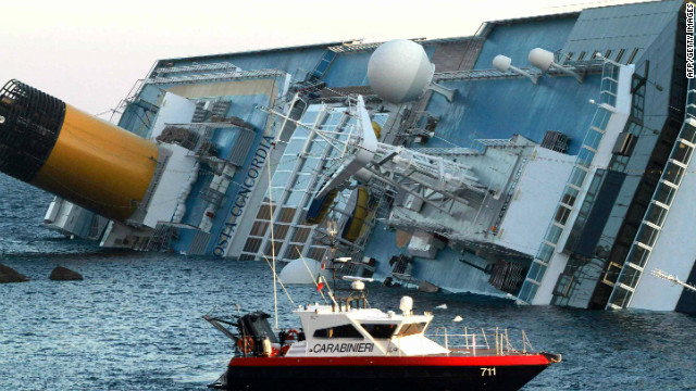 Italian police assist in the rescue after the cruise ship ran aground near the Italian island of Giglio.