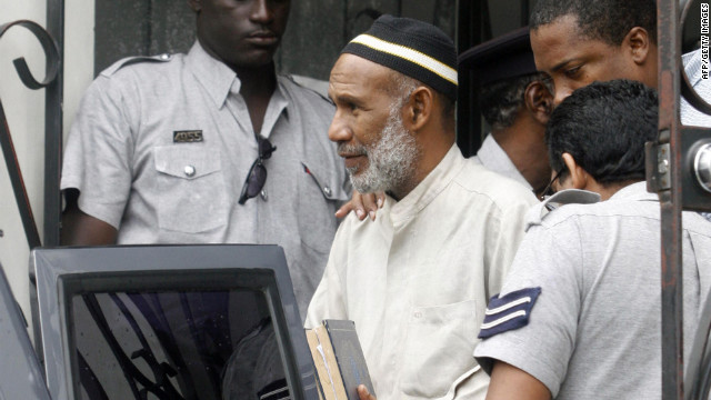 Kareem Ibrahim leaves court in Port of Spain, Trinidad and Tobago, in 2007.