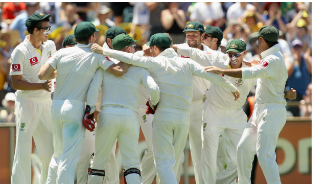Australia players celebrate their comprehensive victory over India in Perth.