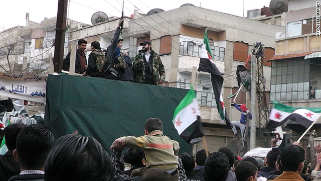The Free Syrian Army (FSA) and their supporters gather in the Khalidiya neighborhood of the flashpoint city of Homs on January 13, 2012.