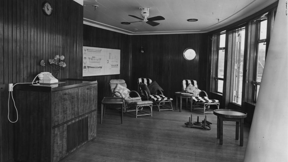 The interior of the veranda lounge on board the Britannia, pictured here in 1954.