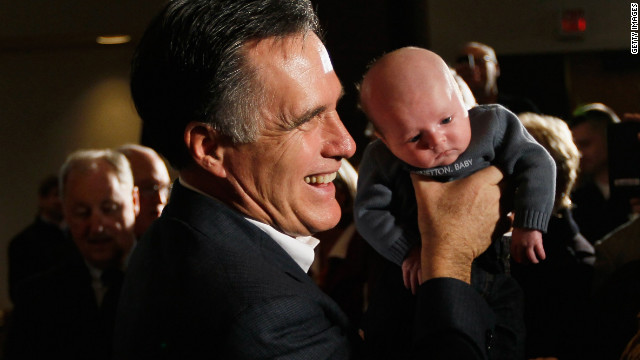 Mitt Romney holds 5-week-old Johnathon Kelly during a rally at the Hilton Oceanfront Resort in Hilton Head Island, South Carolina.