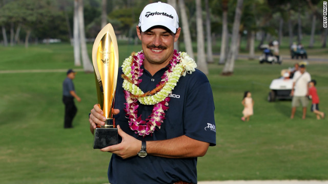 Johnson Wagner, sporting his mustache, celebrates after winning his third PGA Tour title.