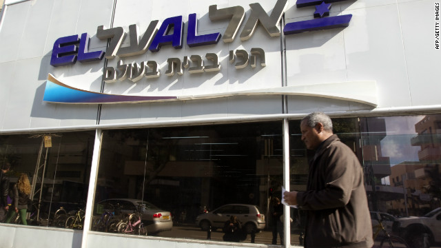 A man walks past an office of Israeli airline El Al in Tel Aviv. The airline's website was brought down by an apparent hacking attack.