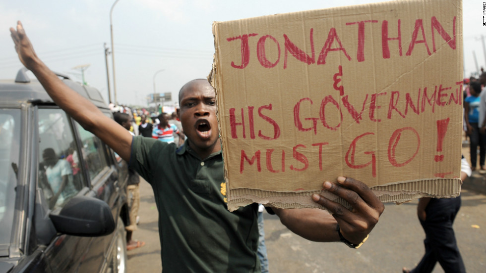 A man protesting against President Jonathan's government for scrapping oil subsidy.