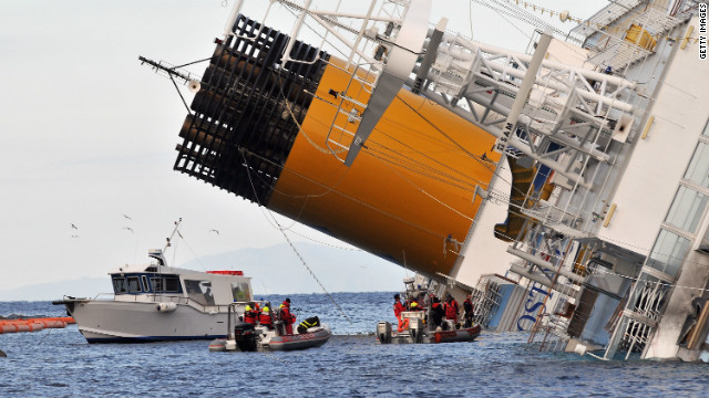 Rescuers work on the cruise ship Costa Concordia as lies stricken off the shore of the island of Giglio, on January 17, 2012 in Giglio Porto, Italy.