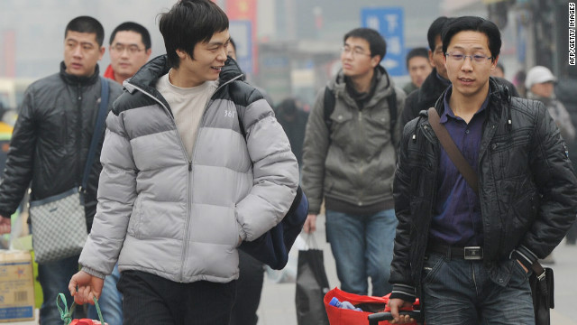Migrant workers prepare to travel back to their rural homes at the start of the Chinese New Year holiday in Beijing on January 17.