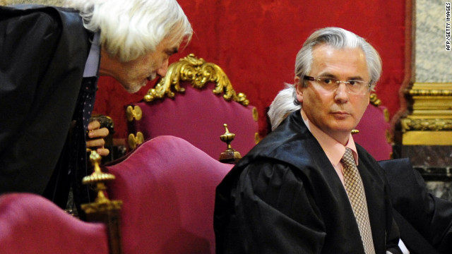 Spanish judge Baltasar Garzon (right) attends the first day of his trial at Spain's Supreme court in Madrid on January 17, 2012.