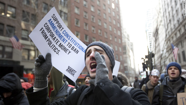 Occupy demonstrators rally on Martin Luther King Day outside the Federal Reserve in New York.