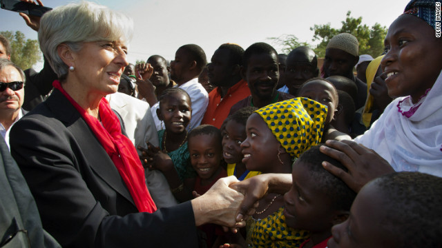 Christine Lagarde greets people in Niamey, Niger, on December 21, 2011, during her first trip to Africa as IMF chief.
