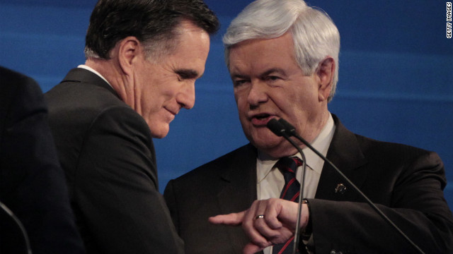 Former Massachusetts Gov. Mitt Romney and former House Speaker Newt Gingrich talk at the end of the South Carolina Republican presidential candidates debate in Myrtle Beach, SC, Monday, January 16, 2012.