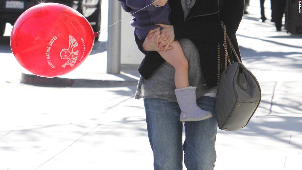 Alyson Hannigan roams around Beverly Hills with her daughter.