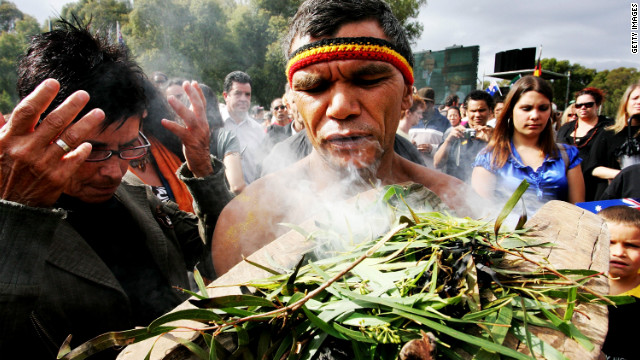 An Aboriginal man performs a smoke cleansing ceremony on the Parliament lawns in Canberra on February 13, 2008.