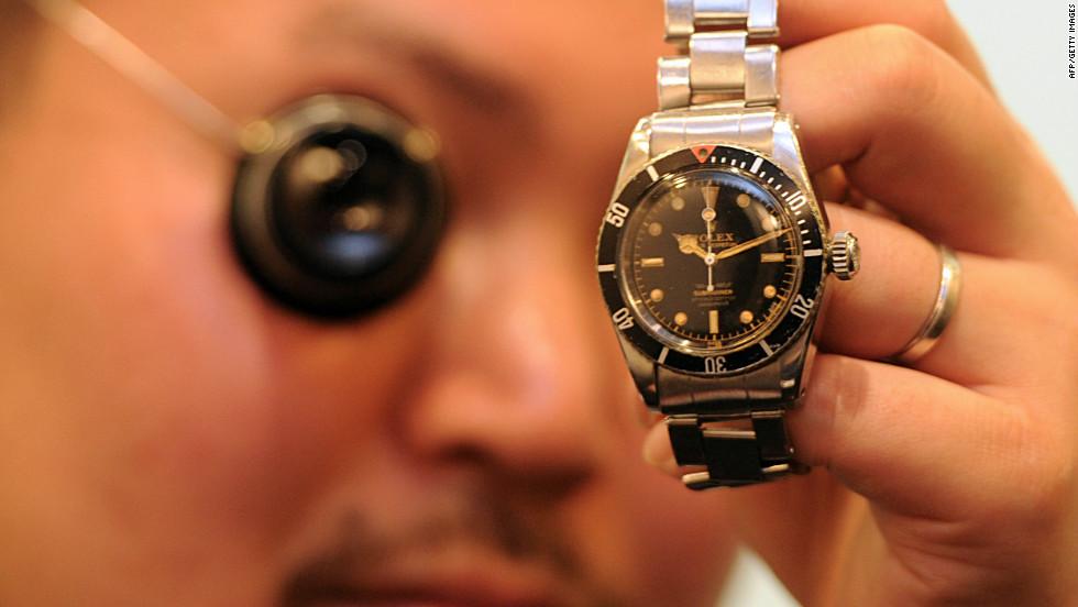 Watch expert Genki Sakamoto examines a 1958 Rolex Submariner in Hong Kong.