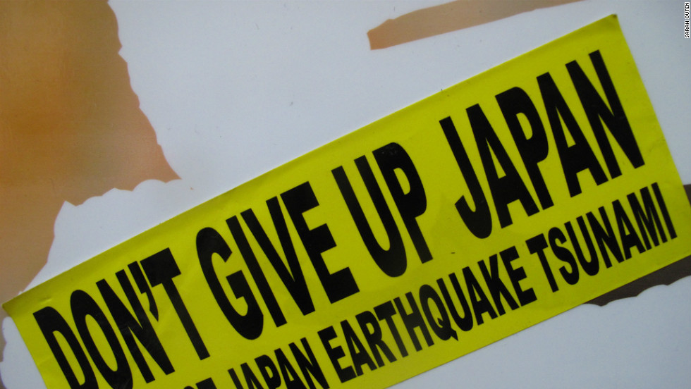 A poster encouraging people not to give up nearly one year after Japan was shattered by an earthquake and tsunami
