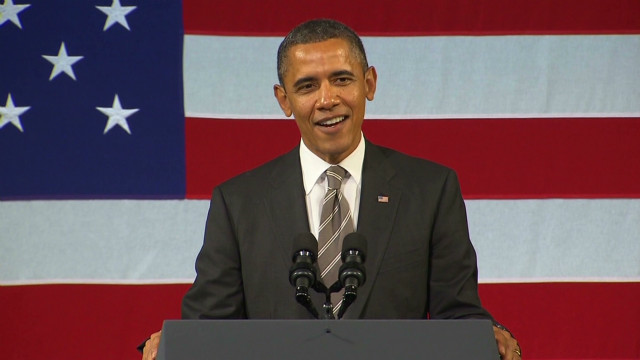 Obama sings, campaigns at the Apollo