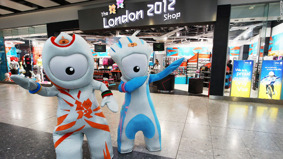 Olympic mascots Wenlock and Mandeville strike a pose outside the London 2012 store at Heathrow Airport.