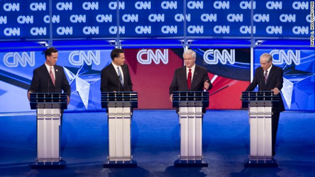 Republican presidential hopefuls, former senator Rick Santorum (L), former Massachusetts governor Mitt Romney (2nd-L), former House Speaker Newt Gingrich (2nd-R) and Texas Rep. Ron Paul (R) participate in the CNN Southern Republican Leadership Conference Town Hall Debate in Charleston, South Carolina, January 19, 2012, in advance of this weekend's January 21, 2012 Republican presidential primary.