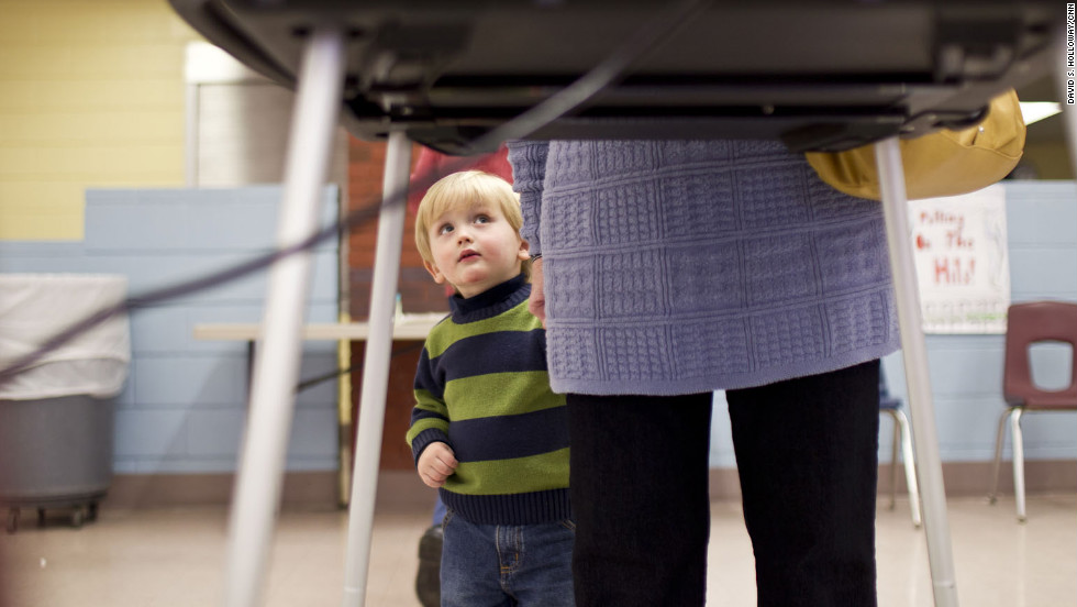 Margie McCoy from Lexington, South Carolina, makes her vote as her grandson, Jacob, curiously watches. South Carolina has voted for the eventual winner of the Republican nomination since 1980.