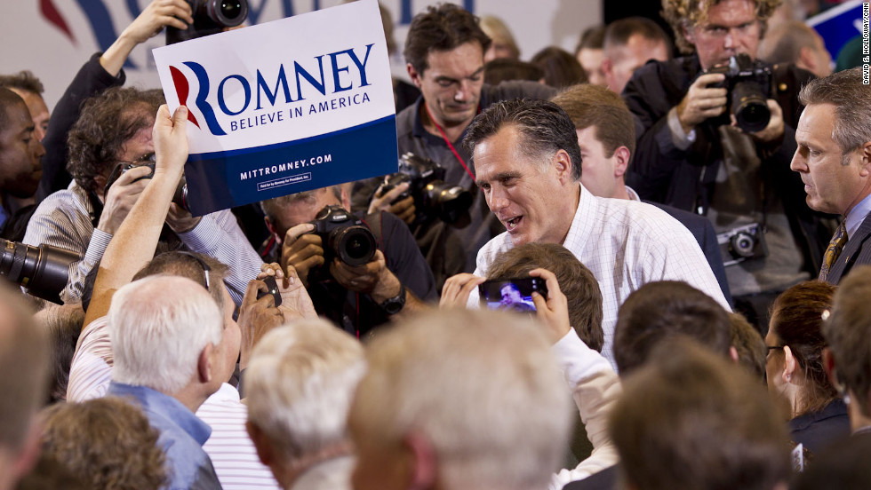 Professional photographers and Romney supporters take photos of Romney during his Grassroots Rally.
