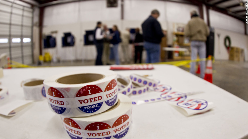 Stickers, given to people after voting, sit on a table inside the Amicks Ferry Polling Station in Chapin, South Carolina, on Saturday, January 21.