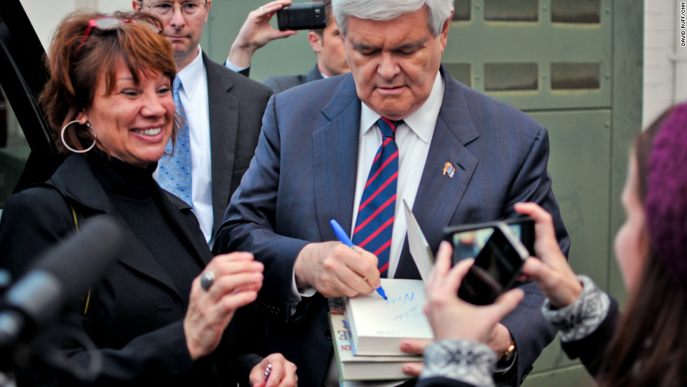 On Friday, just a day before the primary, GOP contender Newt Gingrich spoke to an overflow crowd in Orangeburg. He signs a copy of his book for an attendee.
