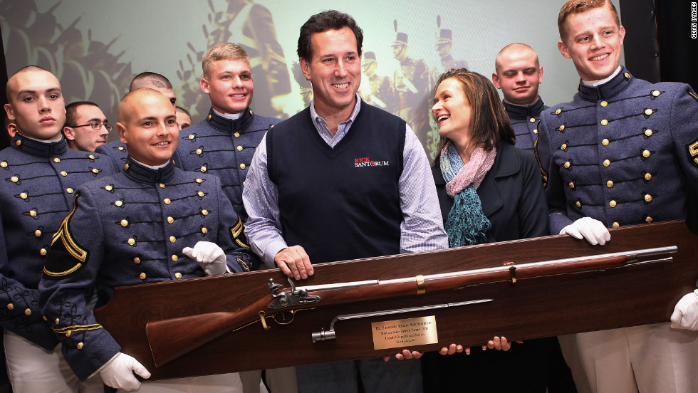 Former U.S. Sen. Rick Santorum stands with Citadel cadets on Friday in Charleston. He received a Revolutionary-era musket as part of the Citadel military college's annual Patriot Award.