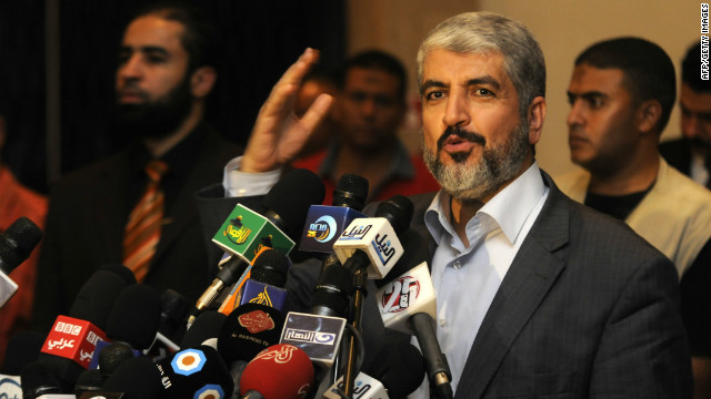 Exiled Palestinian Hamas leader Khaled Meshaal addresses a meeting with some 40 Palestinian prisoners who were freed by Israel but are to be deported overseas, in Cairo on October 18, 2011.
