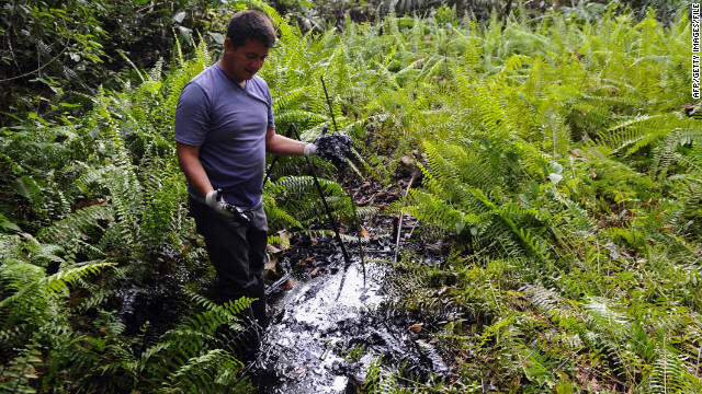 Donald Moncayo, Ecuadorean activist of the Amazonia Defense Front,  shows oil waste near La Primavera in February 2011.
