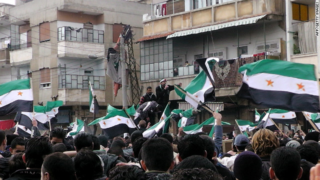 Syrian anti-regime demonstrators wave the former Syrian flags in the Khalidiya neighbourhood, said to be under the control of the Free Syrian Army, in the flashpoint city of Homs on January 20, 2012.