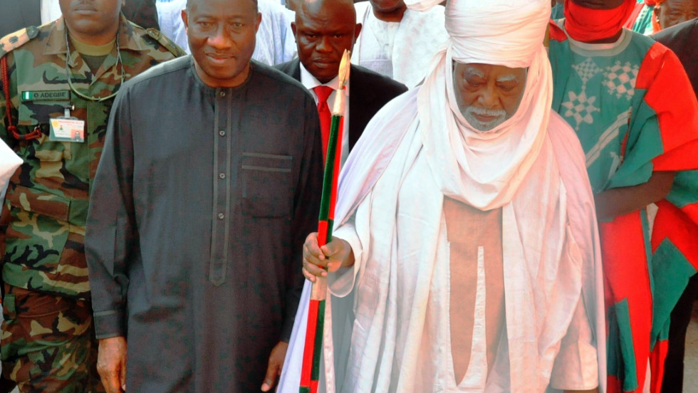 The president walks with the Emir of Kano Ado Bayero at the emir's palace on January 22, 2012 in Kano during a one-day visit to the city that was rocked by multiple explosions that killed more than 150 people.