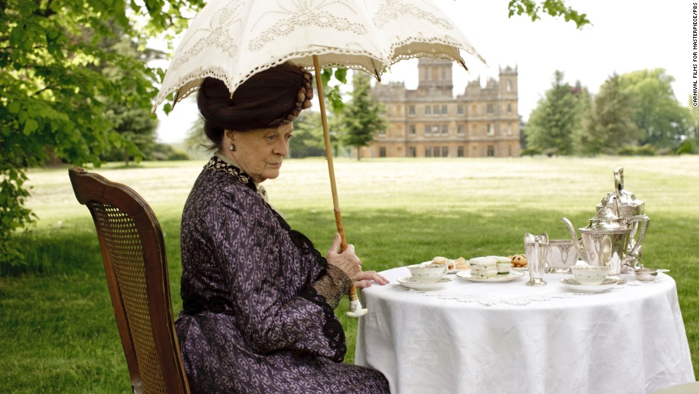 The gorgeous grounds of the castle are a big allure of the show. Here, Dame Maggie Smith, who plays the Dowager Countess of Grantham, has tea outside.
