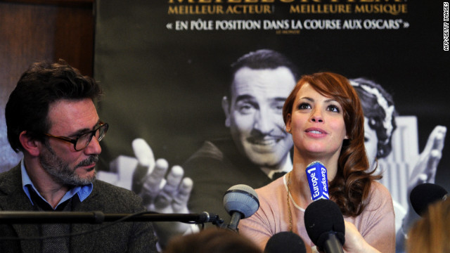 "Michel Hazanavicius, director of ""The Artist,"" and his wife, actress Berenice Bejo, hold a news conference in Paris on Tuesday."