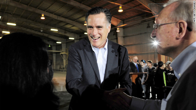 Republican presidential hopeful Mitt Romney greets voters Tuesday after giving a speech at a closed factory in Tampa, Florida.